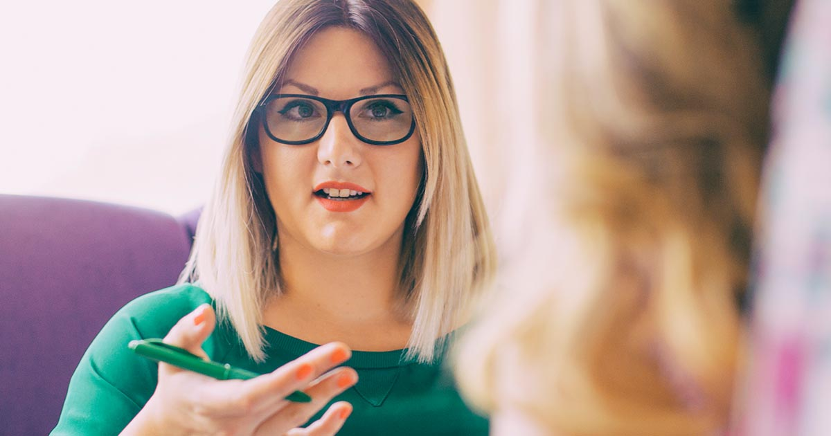 Female counselor talks with a client