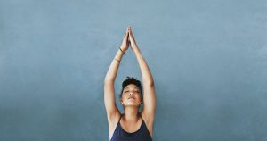 A woman is doing a yoga pose