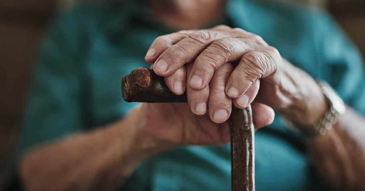 Senior man leaning on his walking stick