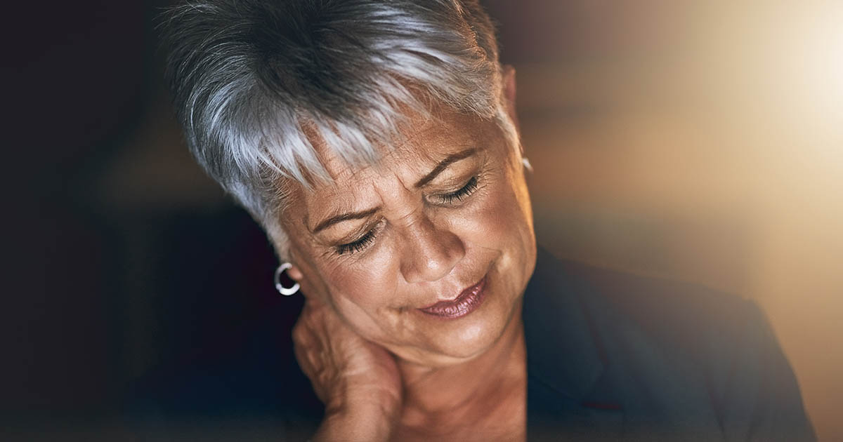 Woman experiencing strain during a late night