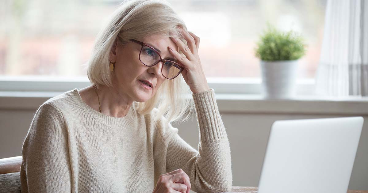 A mature woman is stressed out