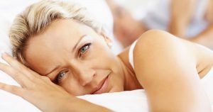 A women is experiencing restlessness in bed