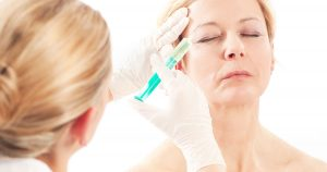 A woman is receiving a botox injection
