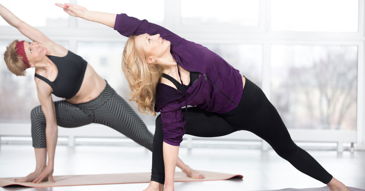 Two women are doing yoga