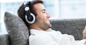A man is listening to music through his headphones
