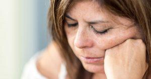 A woman looks upset and sad