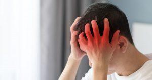 Man experiencing a migraine